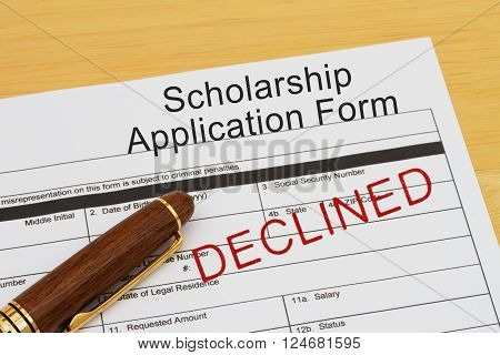 Applying for a Scholarship Declined Scholarship Application Form with Pen on a desk