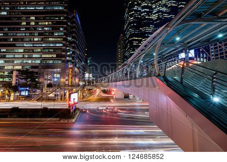 Bangkok Thailand - March 2 2016: Sky walker at the center connected to electric train station colorful in night bangkok city