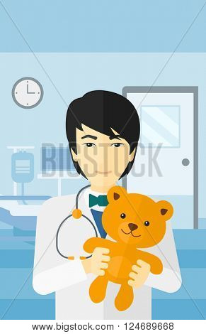 Pediatrician holding teddy bear.