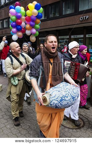 BUDAPEST, HUNGARY - MARCH 25, 2016: Hare Krishna people group with drum and harmonic dancing and singing on the street