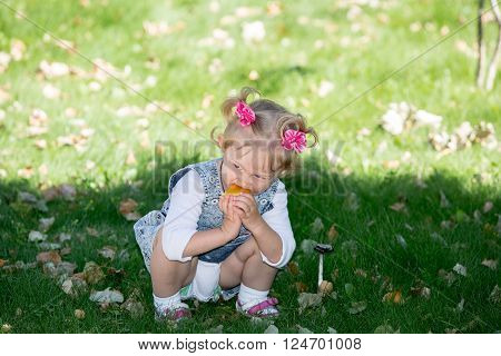 Adorable little child girl. Summer green nature background.  Use it for baby, parenting or love concept