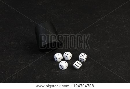 Closeup of 5 dice used for gambling on a table