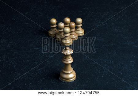 white chess queen and six white chess pawns on a marble table ** Note: Soft Focus at 100%, best at smaller sizes