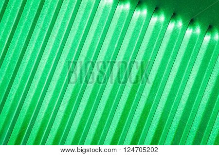 emerald green glitter covered metal panel closeup
