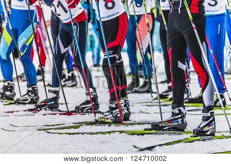 Kyshtym Russia - March 26 2016: Mass start men athletes skiers during Championship on cross country skiing