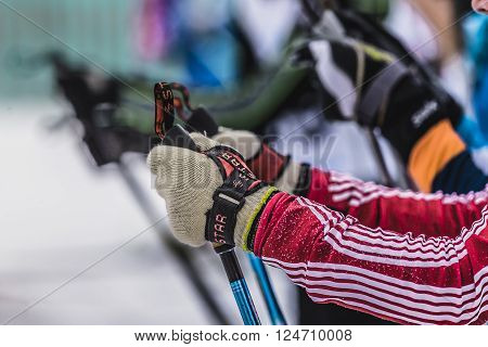 Kyshtym, Russia -  March 26, 2016: Mass start of skiers athletes, closeup of hands and ski poles during Championship on cross country skiing