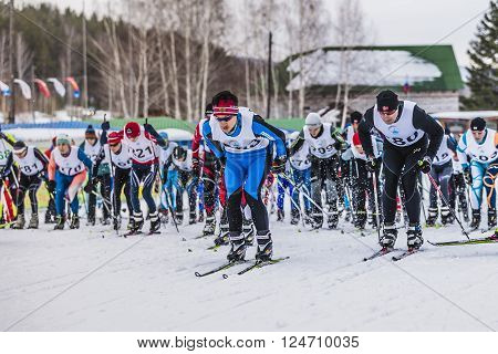 Kyshtym, Russia -  March 26, 2016: Mass start of skiers athletes at marathon distance during Championship on cross country skiing