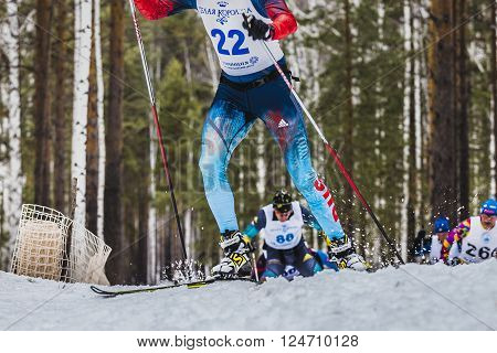 Kyshtym Russia - March 26 2016: group of skiers male athletes up mountain during Championship on cross country skiing