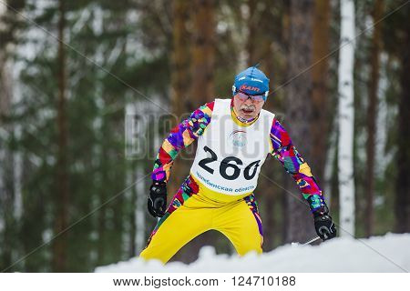 Kyshtym Russia - March 26 2016: old skier athlete men up mountain during Championship on cross country skiing