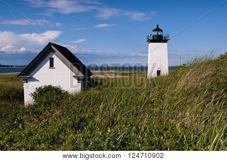 Long Point Light among beach grass on a warm summer day on Cape Cod.