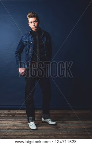 Cool vintage 1950s fashion man in jeans.