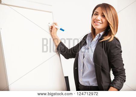 Pretty Businesswoman Writing On A Board