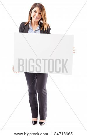 Beautiful Businesswoman With A Big Sign
