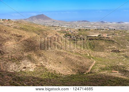 Summer landscape on tropical island Tenerife Canary in Spain. Beautiful view on atlantic ocean from old town Guia de Isora.