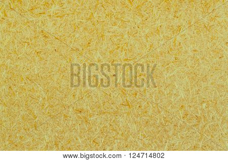yellow wood chippings board texture abstract background