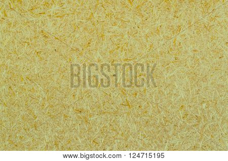 green and yellow wood chippings board texture abstract background
