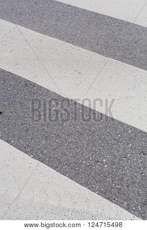 zebra crossing on a concrete road in a city.