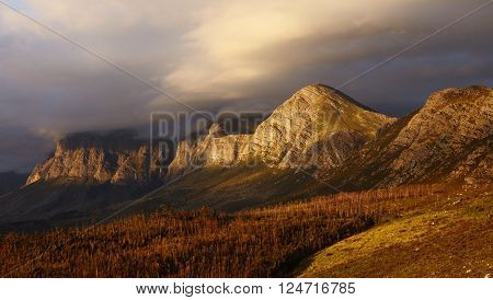 Dramatic shot of stormy clouds sweeping over a moutain range ** Note: Visible grain at 100%, best at smaller sizes