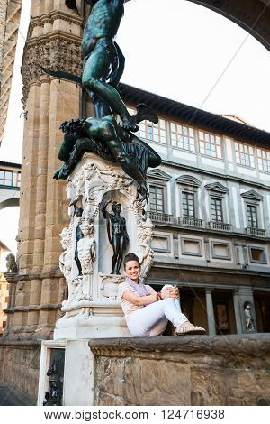 Woman Tourist Sitting In Loggia Dei Lanzi In Florence, Italy