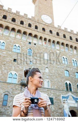 Woman Tourist With Photo Camera Looking Aside. Florence, Italy