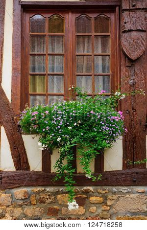 Typical window of a Half-timbered house in Orbec Normandy France