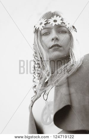 Blonde hippie style girl with peace sign and a crown out. vintage image simulation