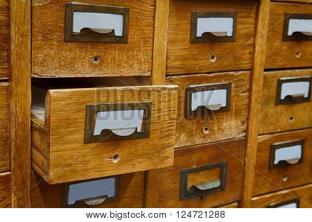Opened box archive storage, filing cabinet interior. Vintage wooden boxes with blank index cards. library service and information management concept.