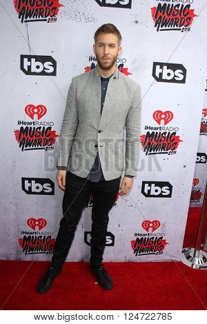 LOS ANGELES - APR 3:  Calvin Harris at the iHeart Radio Music Awards 2016 Arrivals at the The Forum on April 3, 2016 in Inglewood, CA