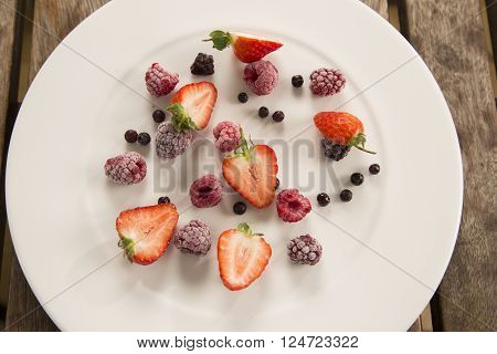 Delectable frozen summer berries with warm white chocolate sauce