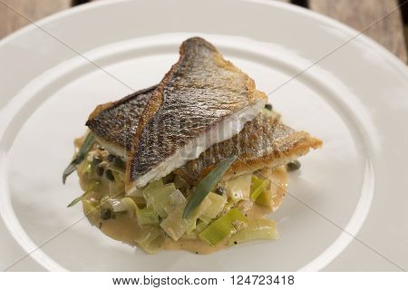 Pan fried sea bream with leeks, crab capers & tarragon