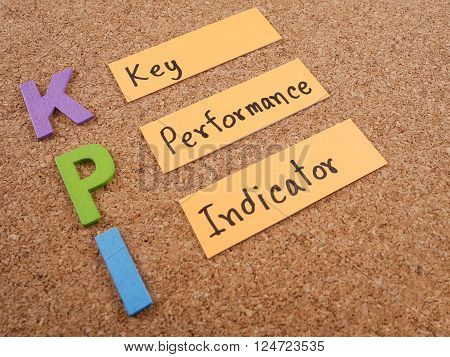 KPI (Key Performance Indicator) with cork board background (Business concept)