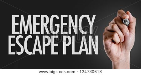 Hand writing the text: Emergency Escape Plan