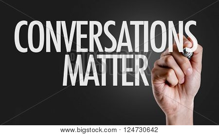 Hand writing the text: Conversations Matter
