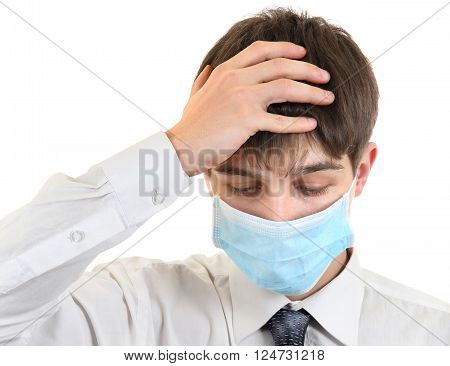 Sad Teenager in Flu Mask on the White Background
