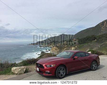 BIG SUR - MARCH 3: Stationary 2016 Ford Mustang at a scenic viewing turnout off California Highway 1 on March 3, 2016 in Big Sur, California, USA.