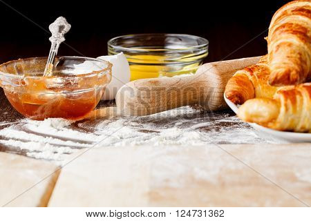 Ingredients For Baking Croissants - Flour, Wooden Spoon, Rolling Pin, Eggs, Egg Yolks