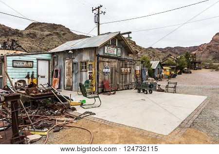 NELSON USA - JUNE 10 : Old wooden house and rusty old fuel pump in Nelson Nevada ghost town on June 10 2015