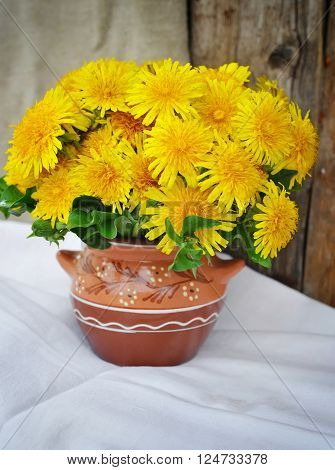 Bouquet Of Dandelions In A Ceramic Jug