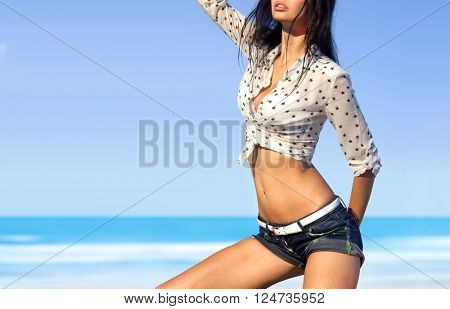 part of beautiful woman in sexy wear on beach of ocean