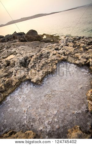 Salty water trapped in Rocks in Bugibba Malta Europe.