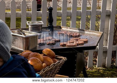 Outdoor Kitchen Hamburger Sizzling On A Frying Table