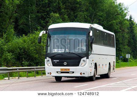 TVER REGION, RUSSIA - MAY 28, 2013: White intercity coach GolAZ 52911 Cruise at the interurban road.