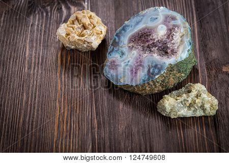 Amethyst crystals in blue smoky quartz on a dark wooden background