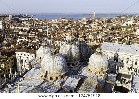 VENICE ITALY - APRIL 23 2015: Venice aerial view of looking over Basilica di San Marco roof. The Patriarchal Cathedral Basilica of Saint Mark is the cathedral church of the Roman Catholic Archdiocese of Venice Italy.