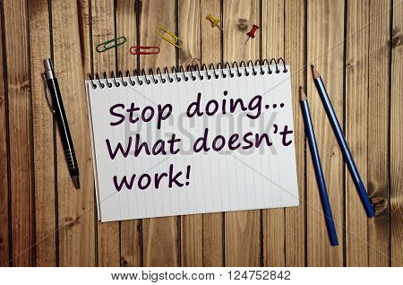 Stop doing what doesn't work text written on notebook