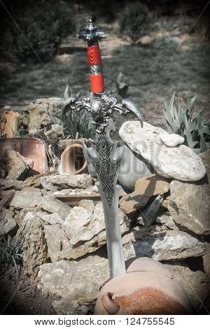 Photo of cold steel against the background of natural stones.