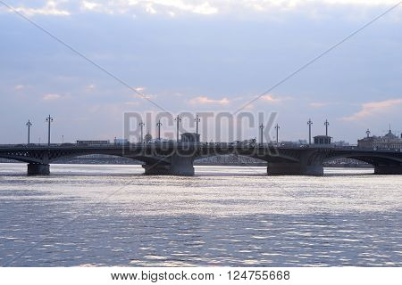 Silhouette of Annunciation bridge and Neva River at sunset St.Petersburg Russia.