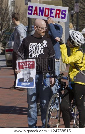 Asheville North Carolina USA - February 28 2016: Bernie Sanders supporters hold signs and display Democratic Socialist t-shirts at a Sanders rally in downtown Asheville NC