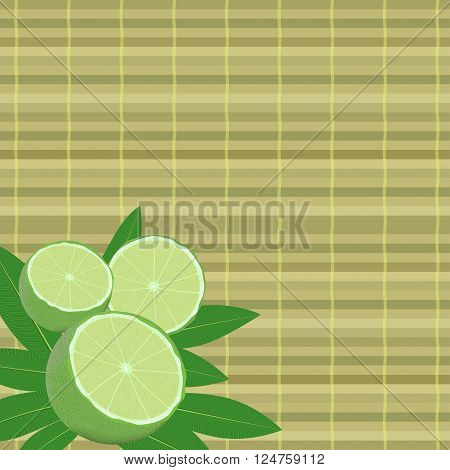 spa leaves and lime in a corner on a bamboo mat background