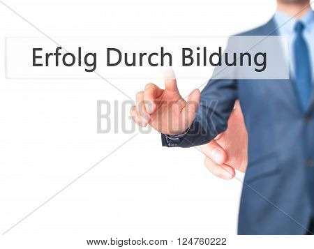 Erfolg Durch Bildung (success Through Training In German) - Businessman Hand Pressing Button On Touc
